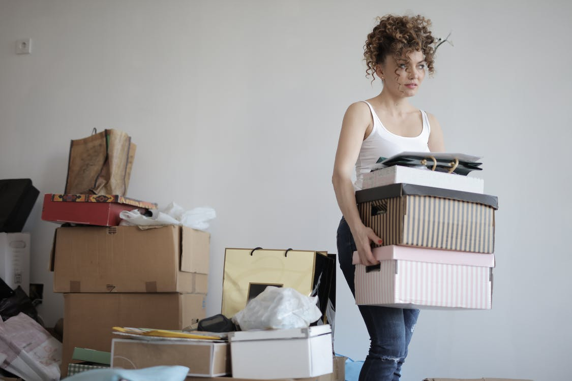 A woman moving the boxes